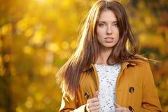 Beautiful autumn woman. In golden park Royalty Free Stock Photo
