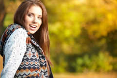 Beautiful autumn woman. In golden park Royalty Free Stock Images