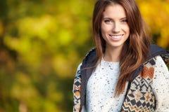 Beautiful autumn woman. In golden park Stock Photo