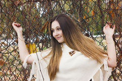 Beautiful autumn woman in golden park. A Beautiful autumn woman in golden park Royalty Free Stock Photos