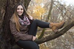 Beautiful autumn woman in golden park. A Beautiful autumn woman in golden park Royalty Free Stock Photo