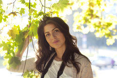 Beautiful autumn woman in golden park Royalty Free Stock Photo