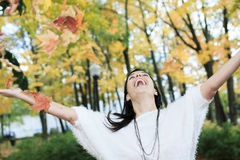 A beautiful autumn woman having good time Royalty Free Stock Image