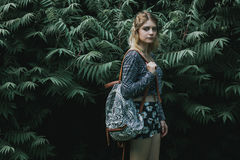 Beautiful autumn woman holding bag against leaves Royalty Free Stock Images