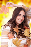 Beautiful autumn woman holding a leaf Royalty Free Stock Images