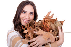 Beautiful autumn woman holding  leaves Royalty Free Stock Image