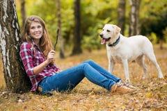 Beautiful autumn woman. With Labrador dog Stock Photo