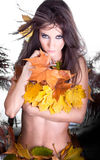 Beautiful Autumn woman with leaf. Studio shot Royalty Free Stock Images