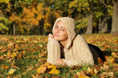 Beautiful autumn woman with leaves in park. Outdoor shot Royalty Free Stock Photos