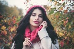 Beautiful autumn woman with long dark hair royalty free stock image
