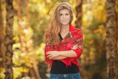 Beautiful autumn woman. With long hair Stock Image