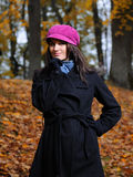 Beautiful autumn woman near yellow tree Royalty Free Stock Photography