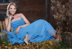 Beautiful autumn woman. Portrait of a beautiful autumn woman in a blue dress Royalty Free Stock Photography