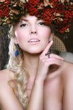Beautiful autumn woman. Portrait of a beautiful autumn woman with garland on several of rowan Royalty Free Stock Photos