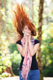 Beautiful autumn woman. With red hair Stock Image