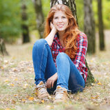 Beautiful autumn woman. With red hair Stock Images