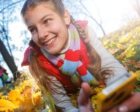 Beautiful young girl - colorful autumn portrait Royalty Free Stock Photography
