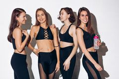 Beautiful awesome fit models in black clothes having fun stock photo