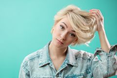 Beautiful awesome model with short blond hair looking at the camera stock photo