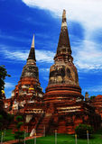 Beautiful Ayutthaya Temple. Khmer temple in Ayutthaya, Thailand Reds and Golds set against a cobalt blue sky Crumbling Ruins of a old civilization Stock Photography