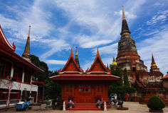 Beautiful Ayutthaya Temple. Khmer temple in Ayutthaya, Thailand Reds and Golds set against a cobalt blue sky Crumbling Ruins of a old civilization Royalty Free Stock Photography