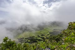 Beautiful Azores Pastures. Beautiful pastures from the rim of Sete Cidades caldera in Sao Miguel royalty free stock image