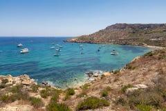 Imgiebah Bay selmun malta. Beautiful azure blue water of Selmun beach in the summer time, in Maltese Imgiebah Bay, Il-Mellieha, Malta, June 2017 Royalty Free Stock Photo