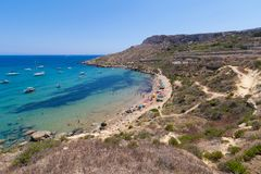 Imgiebah Bay selmun malta. Beautiful azure blue water of Selmun beach in the summer time, in Maltese Imgiebah Bay, Il-Mellieha, Malta, June 2017 Royalty Free Stock Photography