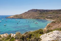 Imgiebah Bay selmun malta. Beautiful azure blue water of Selmun beach in the summer time, in Maltese Imgiebah Bay, Il-Mellieha, Malta, June 2017 Stock Images