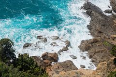 Beautiful azure sea and the rocky beach royalty free stock image