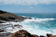 Beautiful azure sea and the rocky beach royalty free stock images