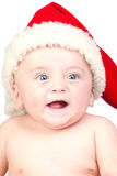 Beautiful babe with blue eyes and Christmas hat Royalty Free Stock Photos