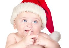 Beautiful babe with blue eyes and Christmas hat Stock Photography