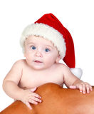 Beautiful babe with blue eyes and Christmas hat Stock Image