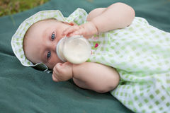 Beautiful baby. Summer portrait of beautiful baby on the lawn Royalty Free Stock Image