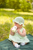 Beautiful baby. Summer portrait of beautiful baby on the lawn Stock Images
