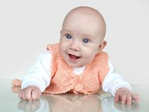 Beautiful baby. Girl portrait on grey background Royalty Free Stock Photo