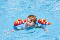 Beautiful baby. Little girl in the swimming pool Stock Images