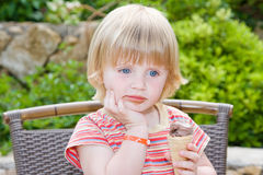 Beautiful baby. Young girl eating in restaurant Royalty Free Stock Photos