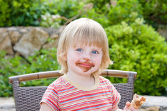 Beautiful baby. Young girl eating in restaurant Stock Photos