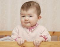 Beautiful baby. Portrait of baby in bed Stock Image