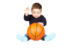 Beautiful baby with a basketball Stock Photos