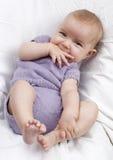 Beautiful baby biting his thumb Royalty Free Stock Images
