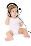 Beautiful baby with black headphones Royalty Free Stock Photo
