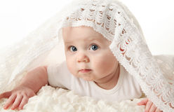 Beautiful baby with blanket on head Stock Photo
