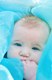 Beautiful Baby with Blue Stock Image