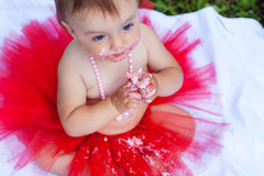 Beautiful baby with blue eyes eating cake Royalty Free Stock Image