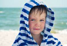 Beautiful baby with blue eyes on the sea background sweet and gentle. Cute child with atopic dermatitis on the background. Of the sea Royalty Free Stock Photo