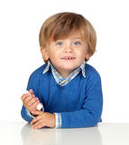 Beautiful baby with blue jersey eating a sweet Stock Photography