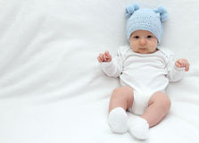 Baby in blue hat Royalty Free Stock Images